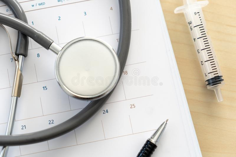 Medical appointment book in the calendar stethoscope and calendar schedule to check up royalty free stock images