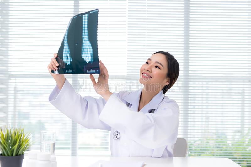 Medical asian doctor working with hologram interface at hospital stock photos