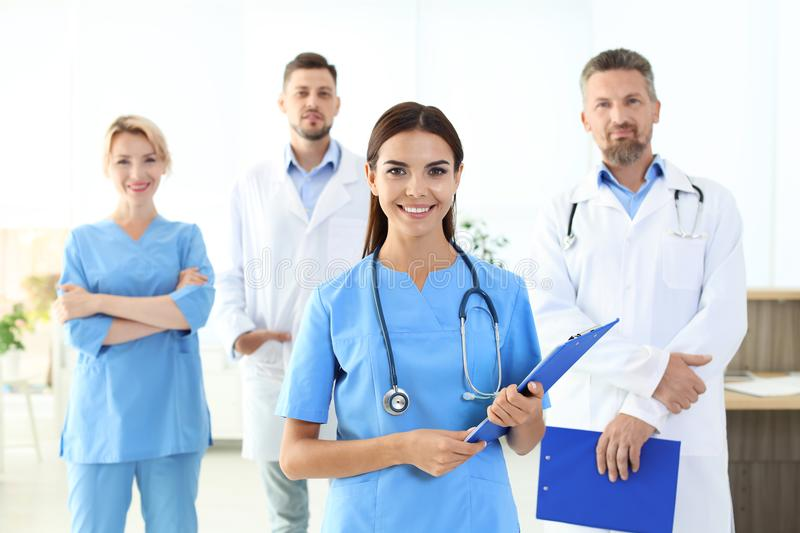 Medical assistant with colleagues in clinic. Health care service royalty free stock photos