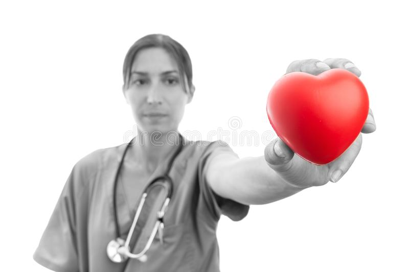 Medical assistant presenting red heart stock photo