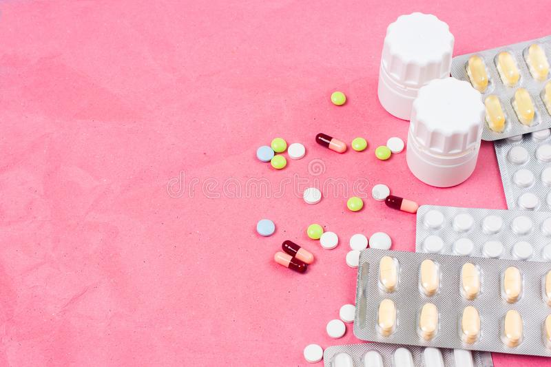 Medical background with colorful pills, tablets and capsules for a slide or presentation royalty free stock photo