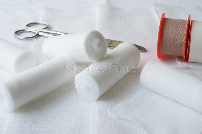 Medical bandages with scissors and sticking plaster. Medical equipment stock photo