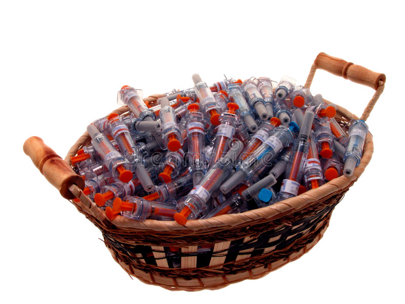Medical: Basket of Used Syringes. Syringe, medical, shot, injection, needle, empty, used, spent, basket, white, orange, blue, daily, medicine, nurse, doctor stock photo