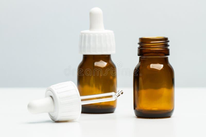 Medical bottles with dropper stock image