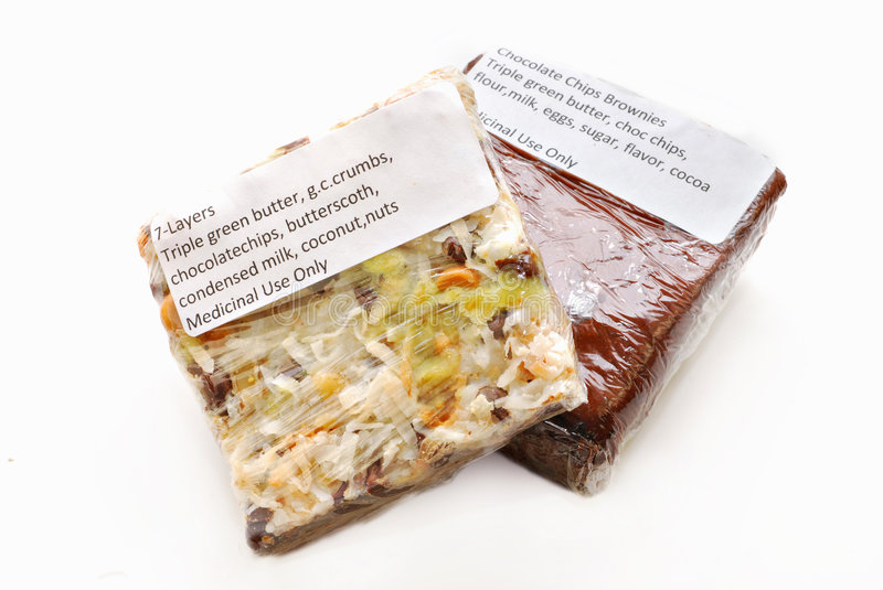 Medical Cannabis Edibles. Brownie and 7-Layer Bar with green butter -- medical cannabis edibles stock image