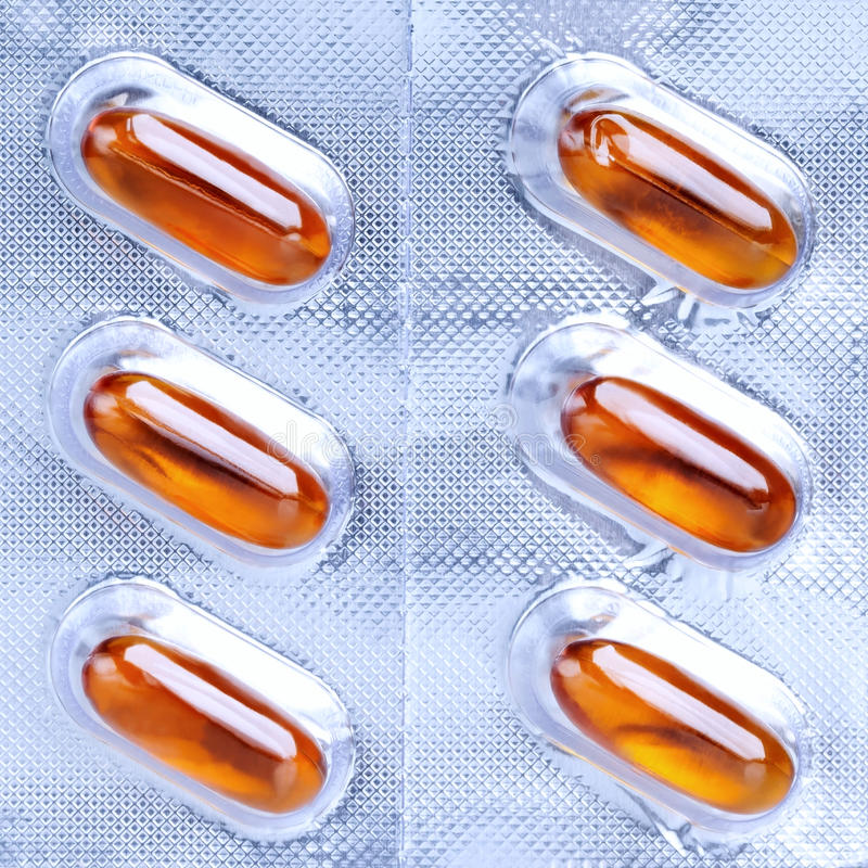 Medical capsules packaged. Medical natural capsules packaged orange color stock photo