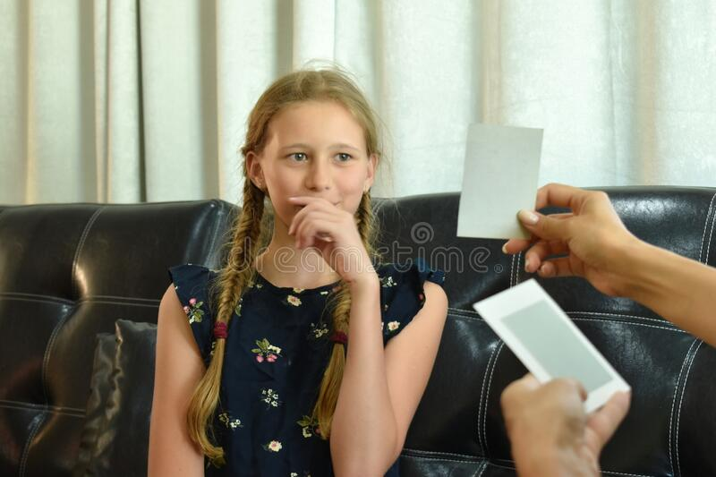 The little girl at the reception of a psychologist. A family therapist. Children`s mental therapy . royalty free stock image