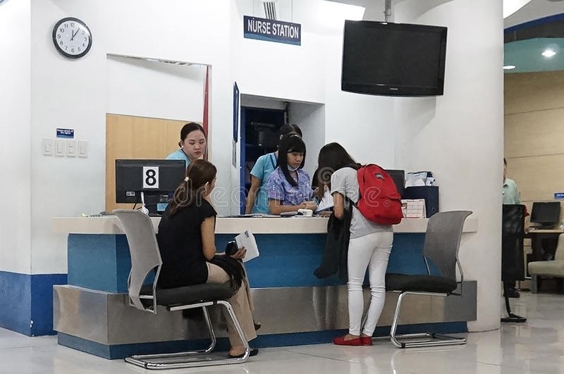 Medical clinic in Asia. Picture of a Medical clinic in Asia showing patients being attended to by medical assistants in the nurse station stock image