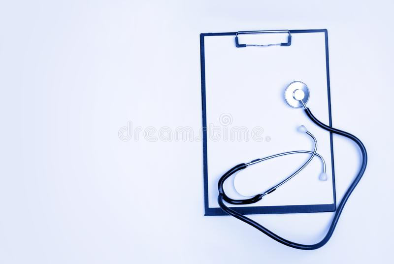 Medical clipboard and stethoscope isolated royalty free stock photo