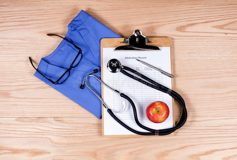 medical clothing and equipment on wooden desktop stock image image