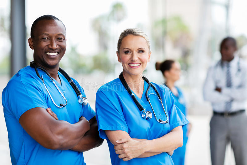 Medical co-workers arms crossed royalty free stock photography