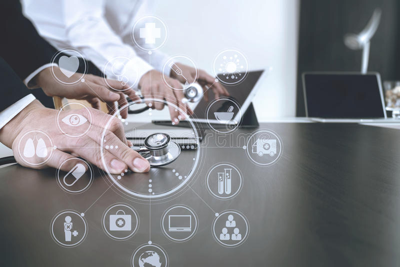 Medical co working concept,Doctor working with smart phone and d. Igital tablet and laptop computer to meeting his team in modern office at hospital with virtual stock image