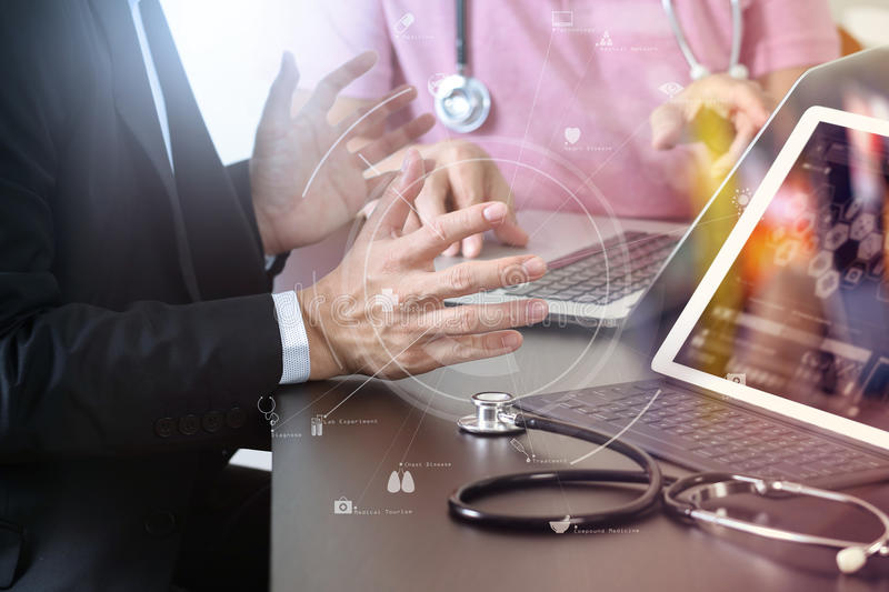 Medical co working concept,Doctor working with smart phone and d. Igital tablet and laptop computer to meeting his team in modern office at hospital with virtual stock photography