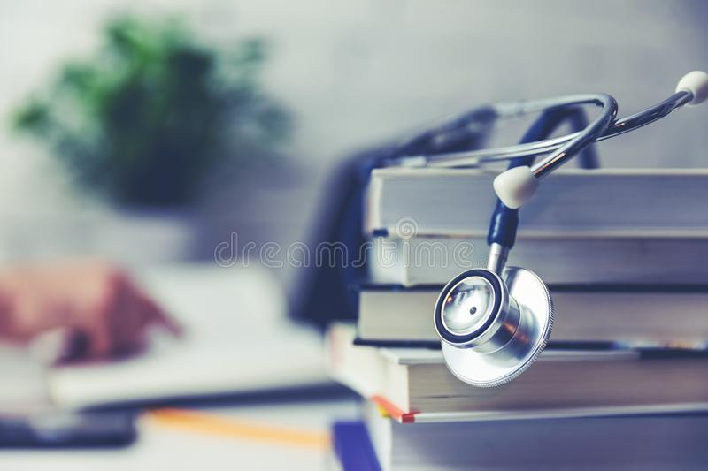 Medical college student with stack of books. Copy space stock photo