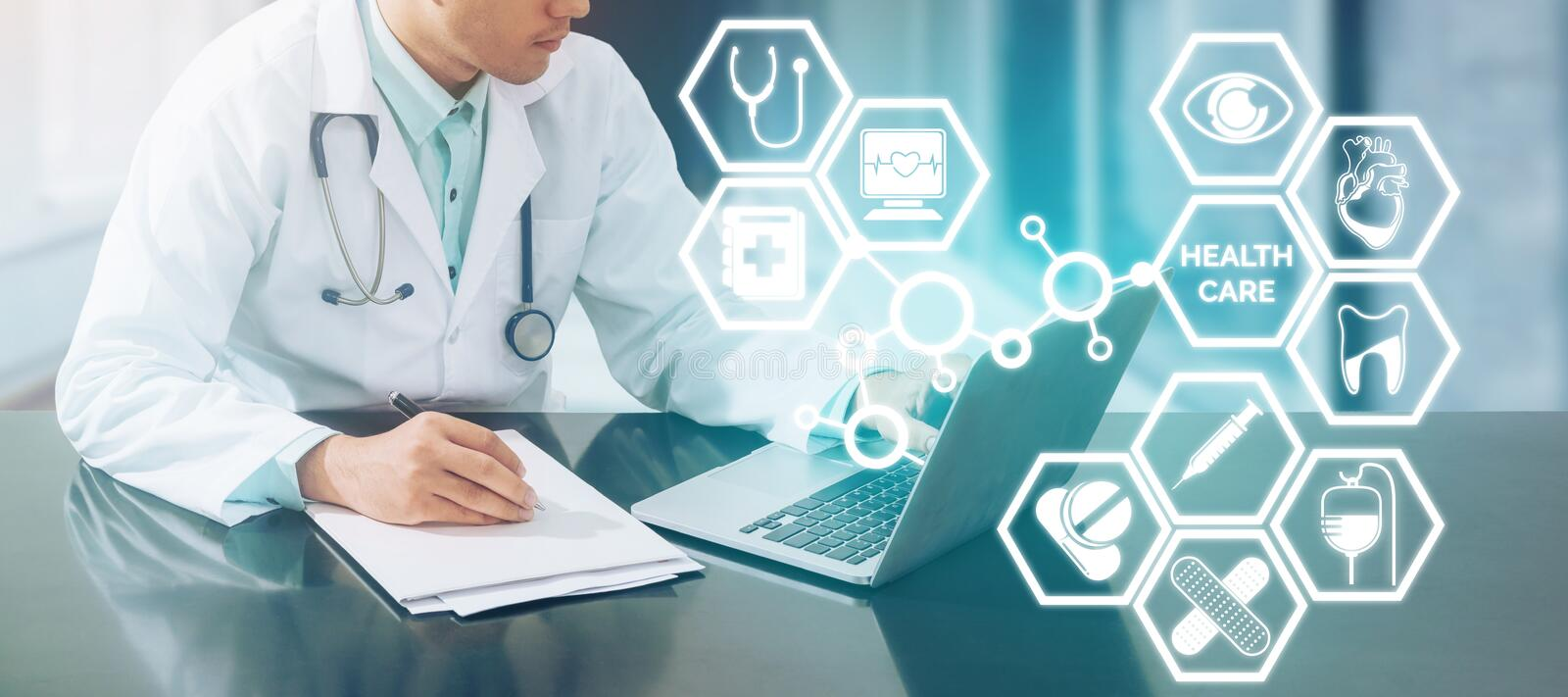 Medical concept - Doctor on Computer with Icons. Medical Concept - Doctor working in hospital with computer and writing paperwork illustrated with medical icons stock images