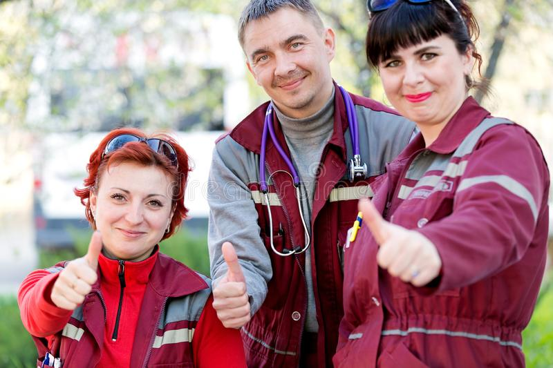 Medical concept. Happy paramedics workers gesturing ok stock image