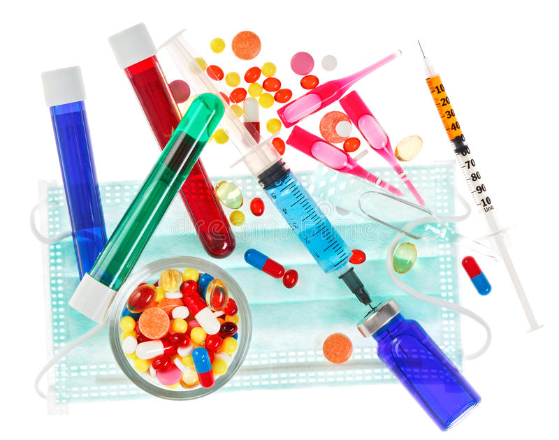 Medical concept with pills, ampoules and syringes royalty free stock photos