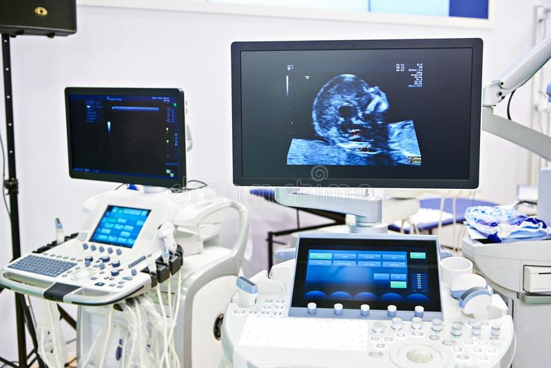 Medical devices for ultrasound examination and screen child head. Image royalty free stock photo