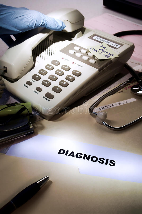 Medical Diagnosis and Doctor Hand after Phone Call stock image