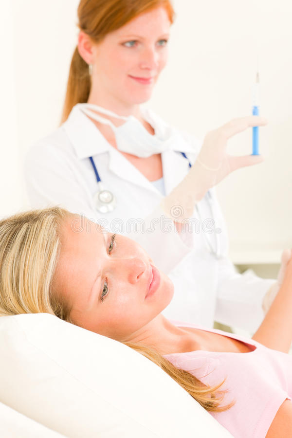 Free Medical Doctor Apply Injection To Woman Patient Stock Image - 20576561