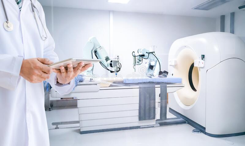 Medical doctor control robot of x-ray machines hospital royalty free stock image