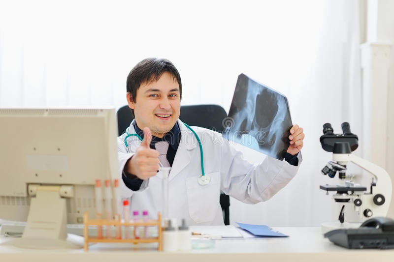 Medical doctor holding patients roentgen stock images