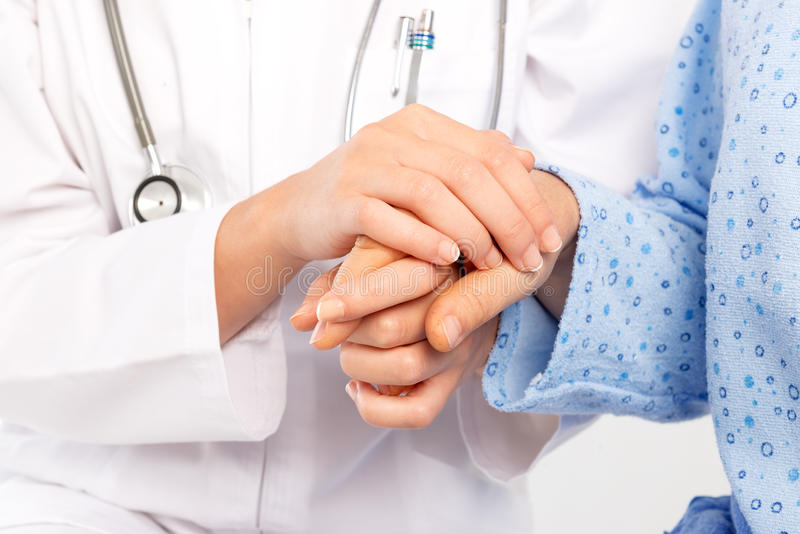 Medical doctor holing senior patient's hand stock images