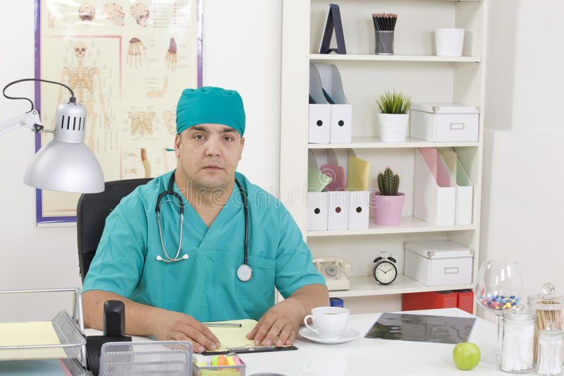 Medical doctor in the office. Sitting stock image