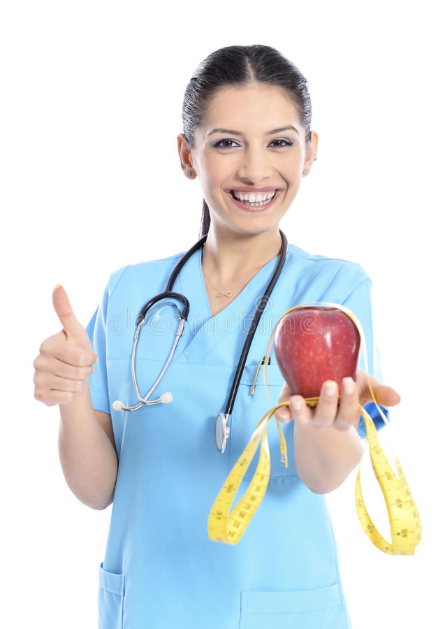 Medical doctor showing apple. Doctor - nurse woman giving / showing apple. Young female medical professional isolated on white background stock images