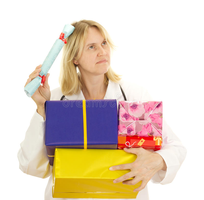 Medical doctor with some gifts stock photos