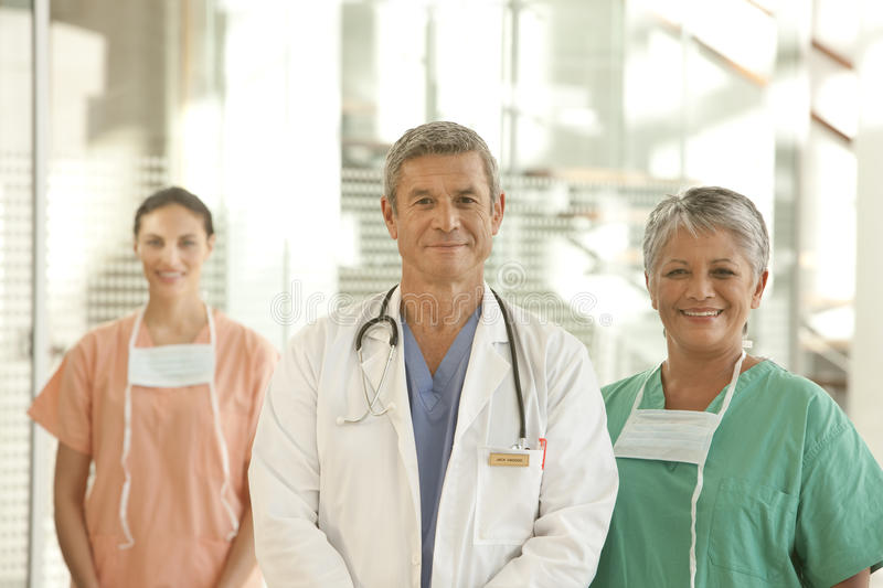 Medical doctor and staff. Portrait of medical doctor and staff royalty free stock photography