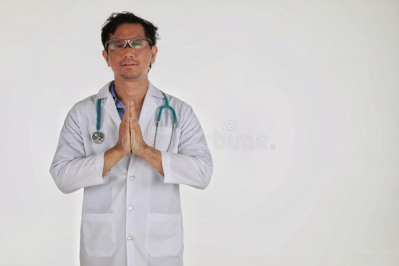 Copy space The medical doctor physician doing hand gesture please isolated  white background stock photo