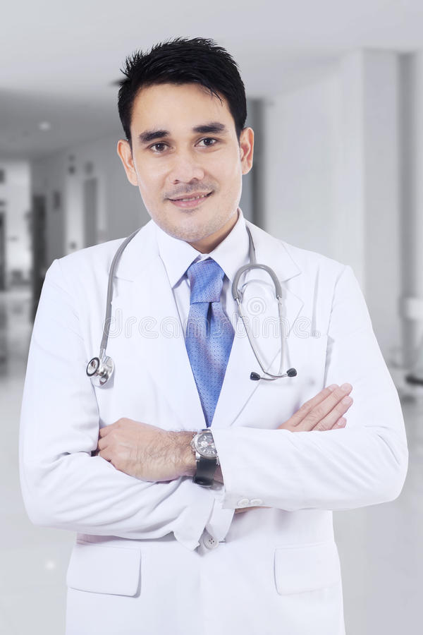 Medical doctor standing in hospital corridor royalty free stock image