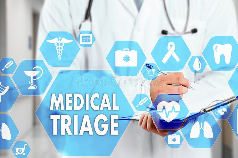 Medical Doctor with stethoscope and MEDICAL TRIAGE sign in Medical network connection on the virtual screen on hospital background stock photo