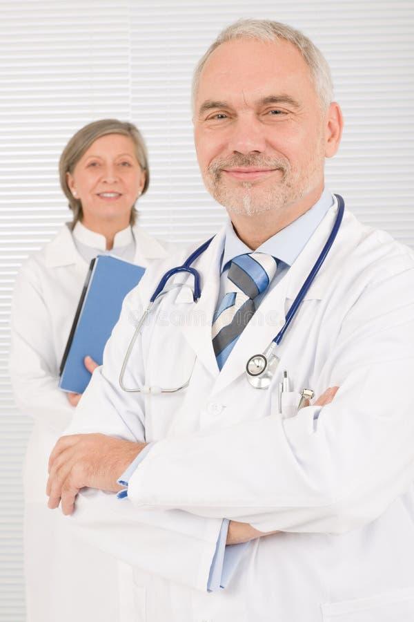 Medical doctor team seniors hold folders stock photo