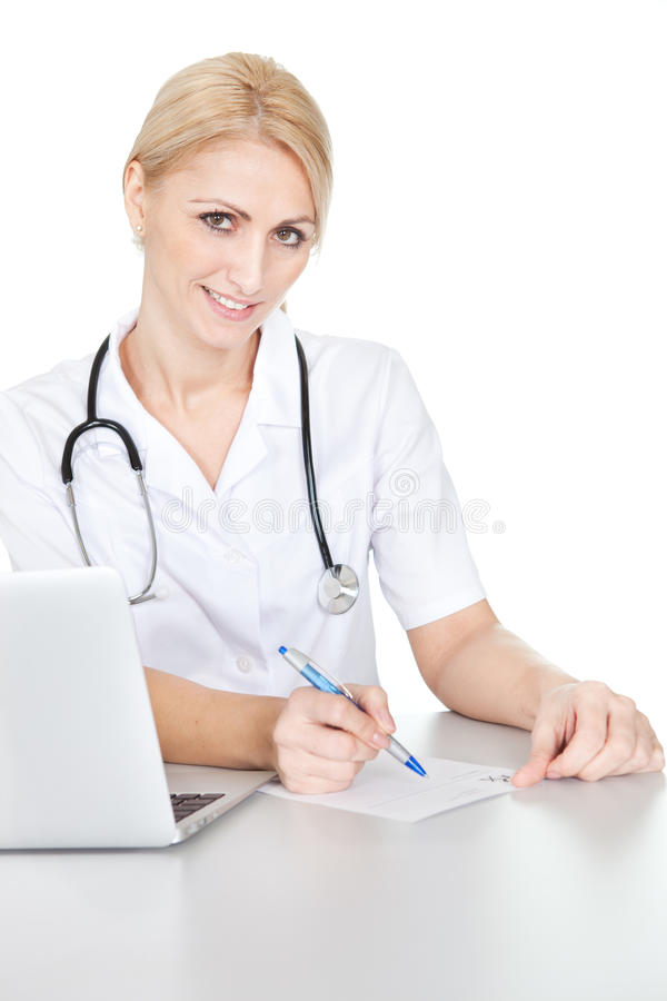 Download Medical Doctor Woman Filling Out Prescription Stock Photo - Image: 23081716