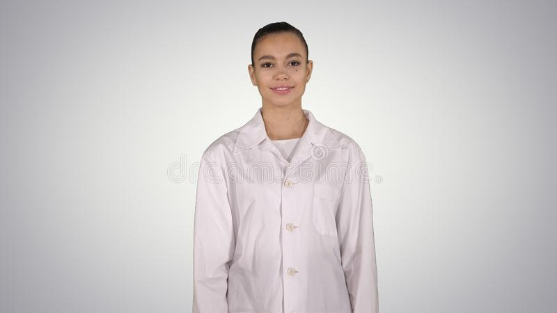 Medical doctor woman going straight on gradient background. royalty free stock image