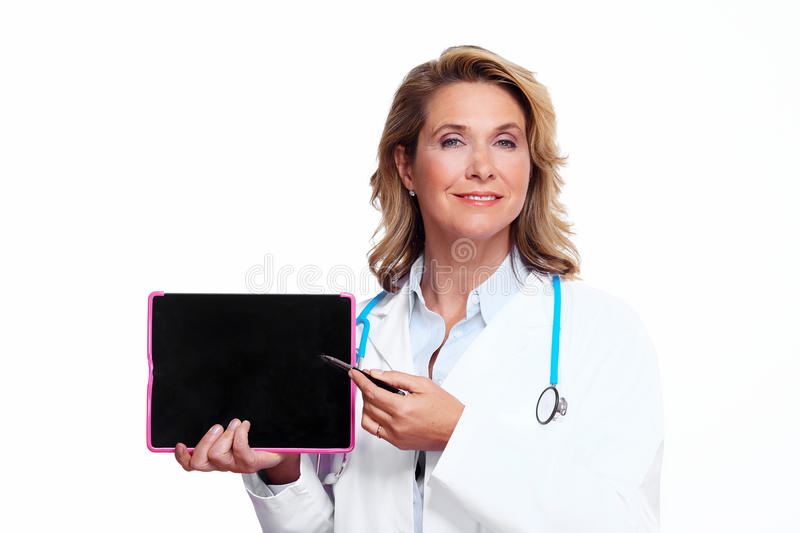 Medical doctor woman with tablet computer. Smiling medical doctor woman with tablet computer. Isolated on white background stock photo