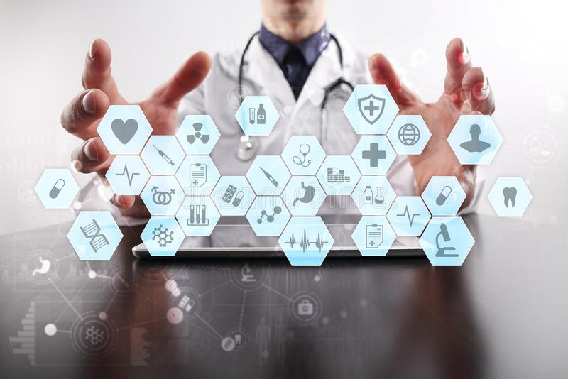 Medical doctor working with modern computer virtual screen interface. Medicine concept. EHR, Electronic Health Records. stock photo