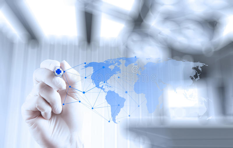 Medical Doctor working with new computer touch screen. Show the world globe as medical network concept stock photo