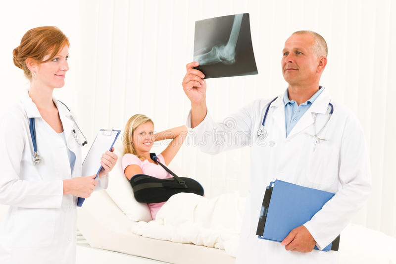 Medical Doctors Look X-ray Patient Broken Arm Royalty Free Stock Images