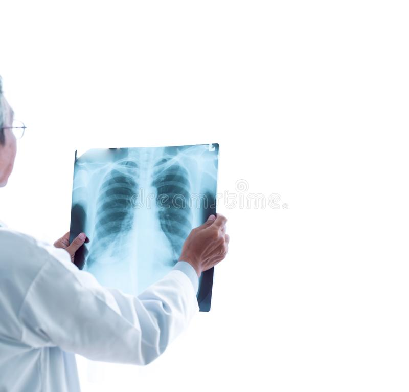Medical doctors looking at x-rays in a hospital .checking chest x ray film at ward with nurse and female doctor Surgeon. stock image