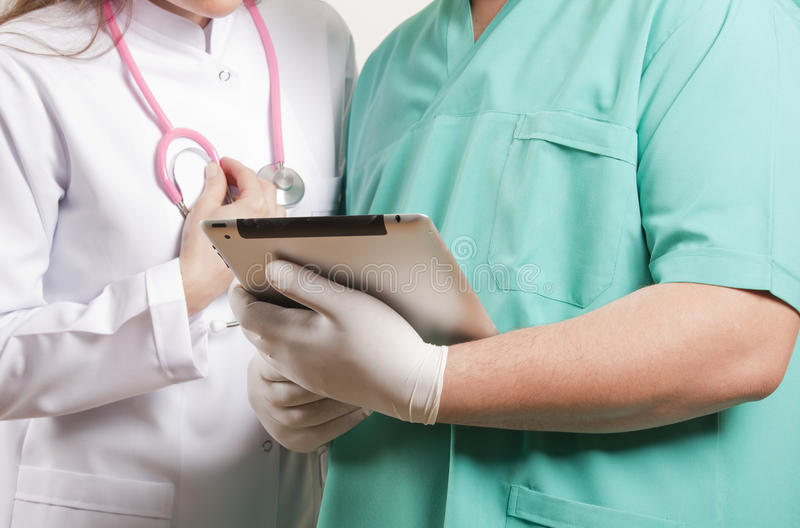 Download Medical Doctors Looking At Tablet Pc Stock Photo - Image: 24238690