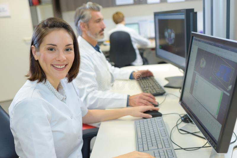 Medical doctors using computer. Medical doctors using the computer stock photography