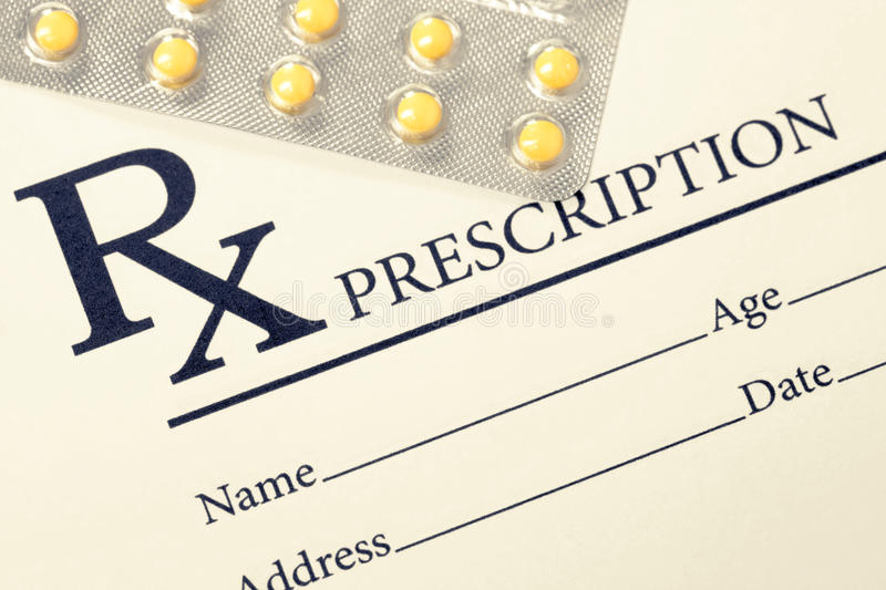 Medical drug prescription and pills over it. Filtered image: cross processed vintage effect. royalty free stock photography