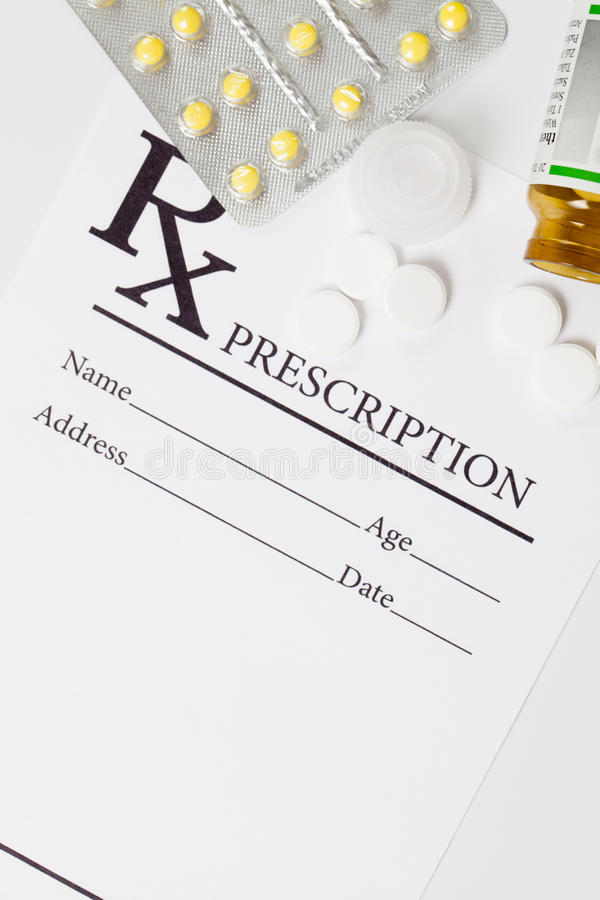 Medical drug prescription and pills over it - studio shot stock images