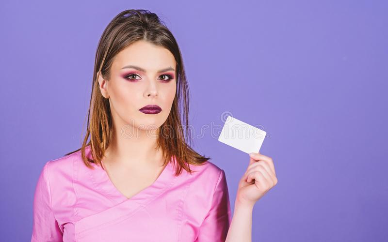 Medical education. Medicine concept. Private clinic. Woman pretty doctor wear uniform. Girl doctor hold business card. Copy space. Medical treatment stock image