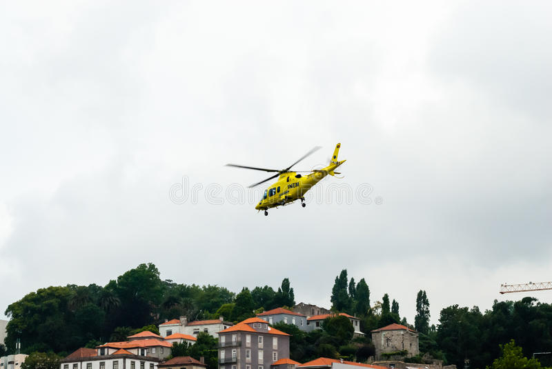 Medical emergency helicopter takes off in Porto, Portugal. stock photos