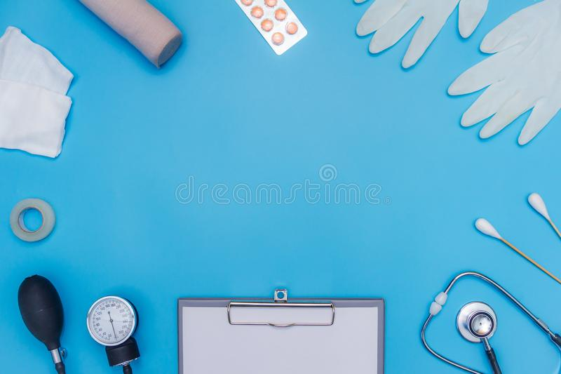 Medical equipment on blue background with text area.  stock photography