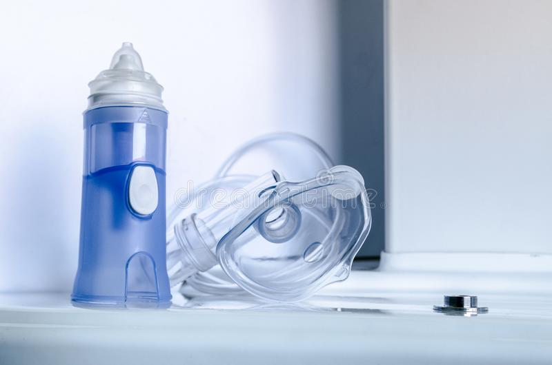 Medical equipment for inhalation with respiratory mask, nebulizer. Treatment of asthma and bronchitis. Medical equipment and drugs for treatment of asthma royalty free stock images